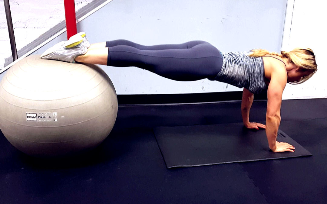 Get a tight core with Stability Ball Knee Tucks