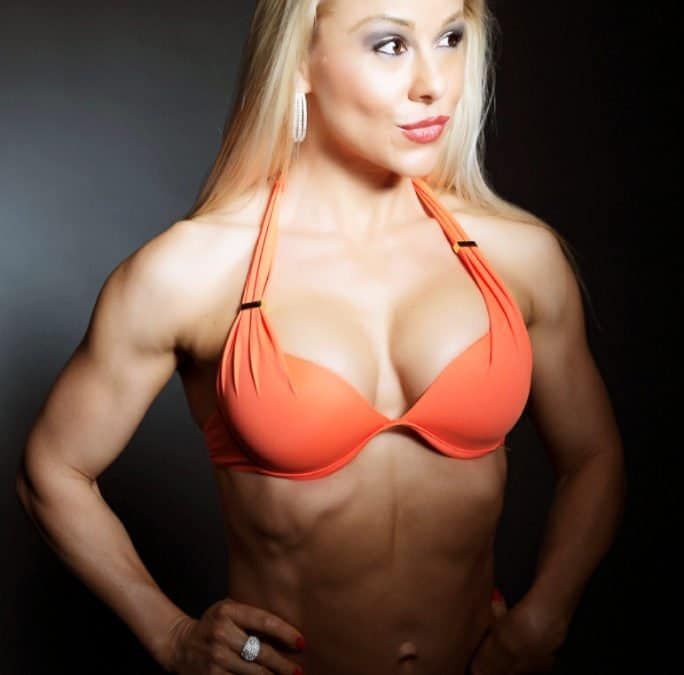 Adriana Albritton showing benefits of lateral side raises