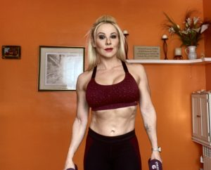 Adriana Albritton preparing to do shoulder presses