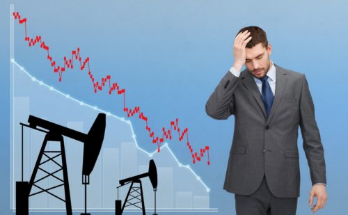 businessman with forex chart and pumpjacks