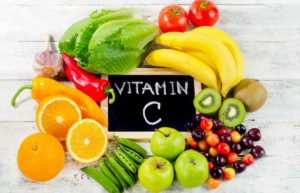 Foods High in vitamin C on a wooden board.