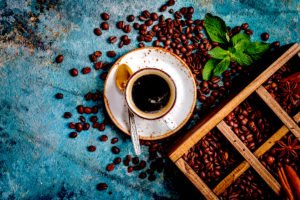 coffee and coffee beans in old wooden box