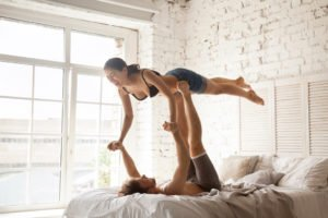 young married couple in love acroyogis practise