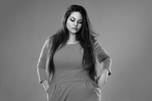 fat woman on gray background