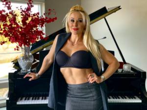 Adriana Albritton standing near the piano