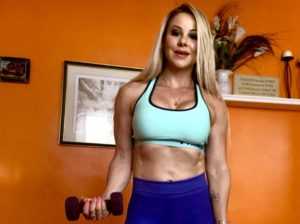 Adriana Albritton doing bicep curls at home