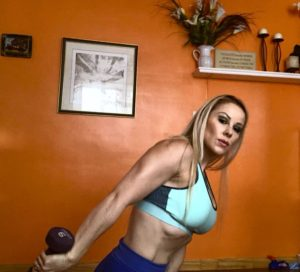 Adriana Albritton doing tricep kickbacks at home