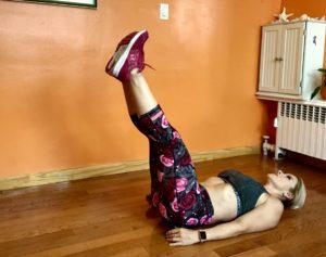 Adriana Albritton doing lying leg raises with hip thrusts