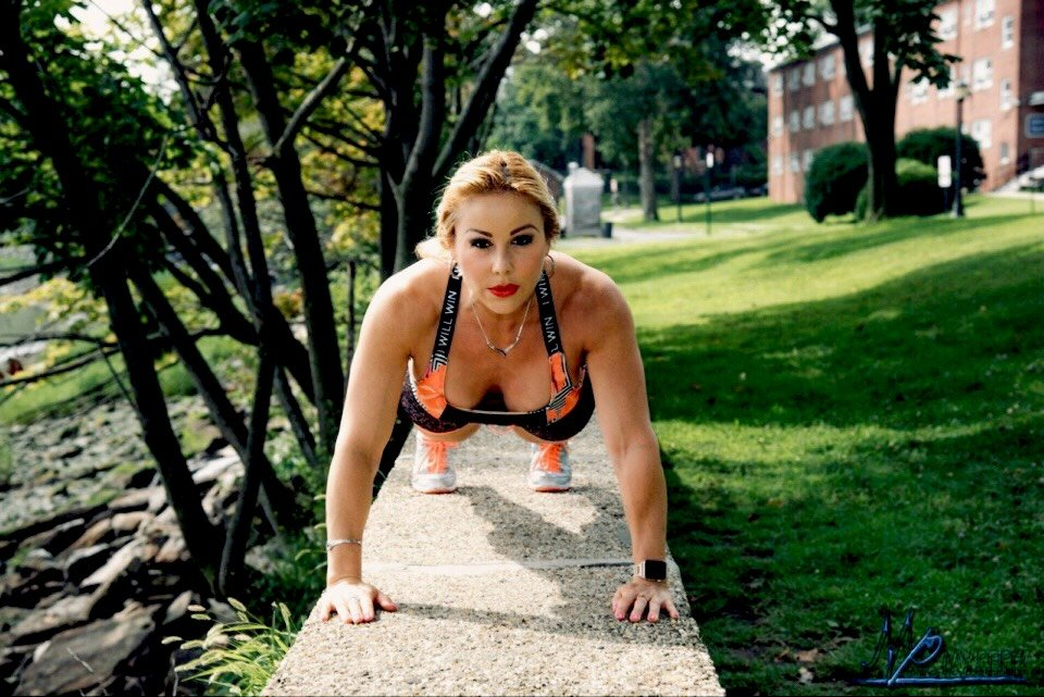 Adriana Albritton doing pushups outside