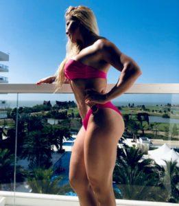Adriana Albritton leans on the balcony rail